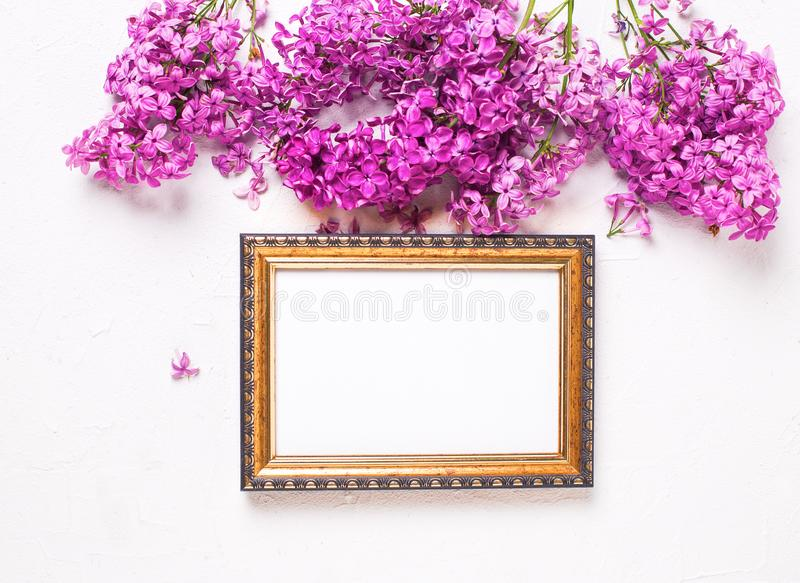 Empty tag and flowers flat lay royalty free stock photography