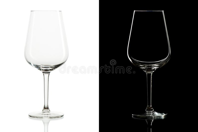 Empty tall wine glasses on black and white background stock photography