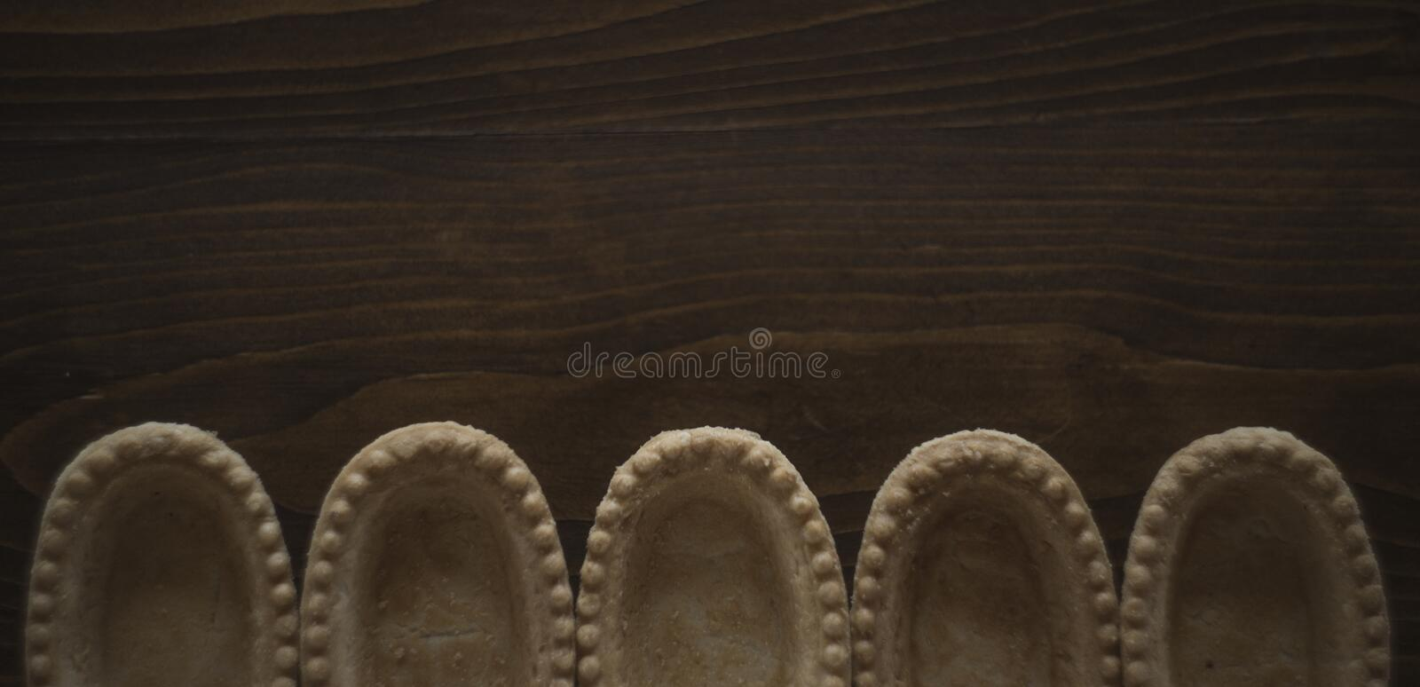 Empty tarts without ingredient at brown wooden background, bakery and bread preparing photo royalty free stock images