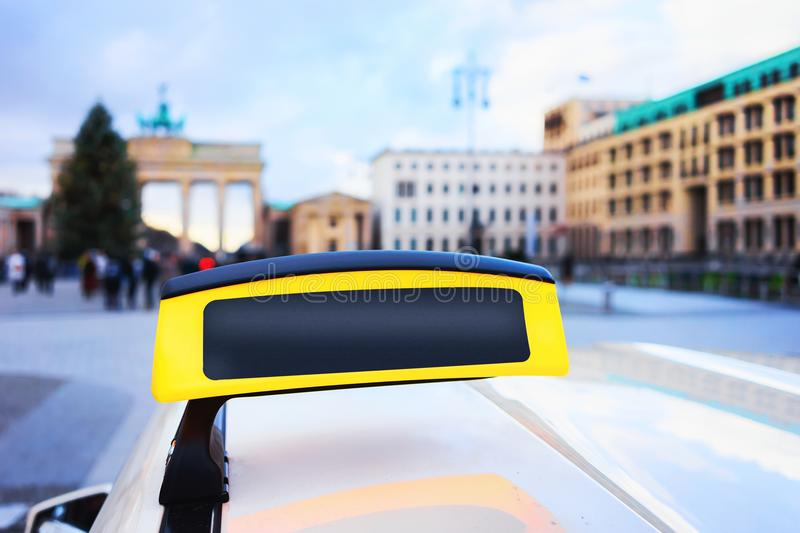 Empty Taxi sign board in street of Berlin Brandenburg gate stock images