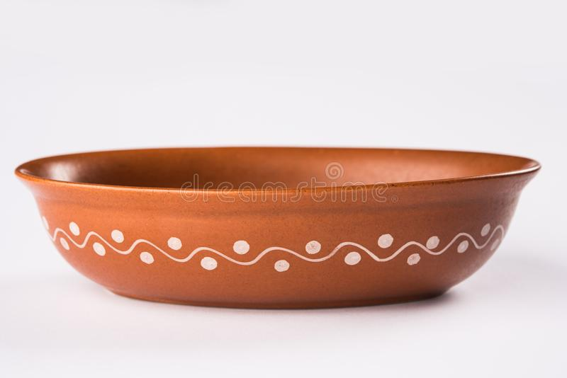Empty terracotta serving bowl or brown clay soup bowl isolated on white. Empty terracotta serving bowl or brown clay soup bowl , popular handicraft from India stock image