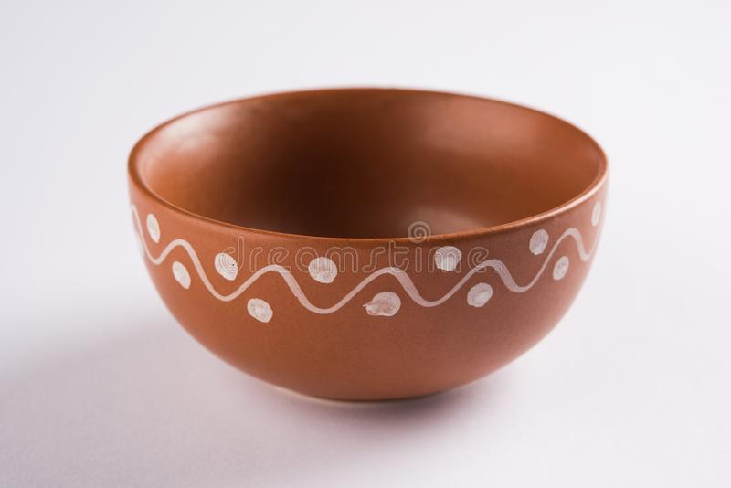 Empty terracotta serving bowl or brown clay soup bowl isolated on white. Empty terracotta serving bowl or brown clay soup bowl , popular handicraft from India royalty free stock images