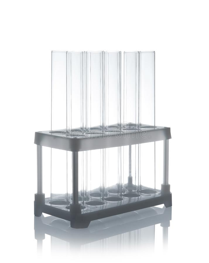 Empty test tubes in holder on table royalty free stock photography
