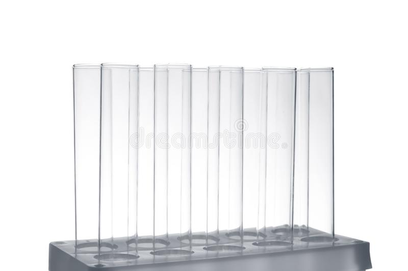 Empty test tubes in holder on white background stock image