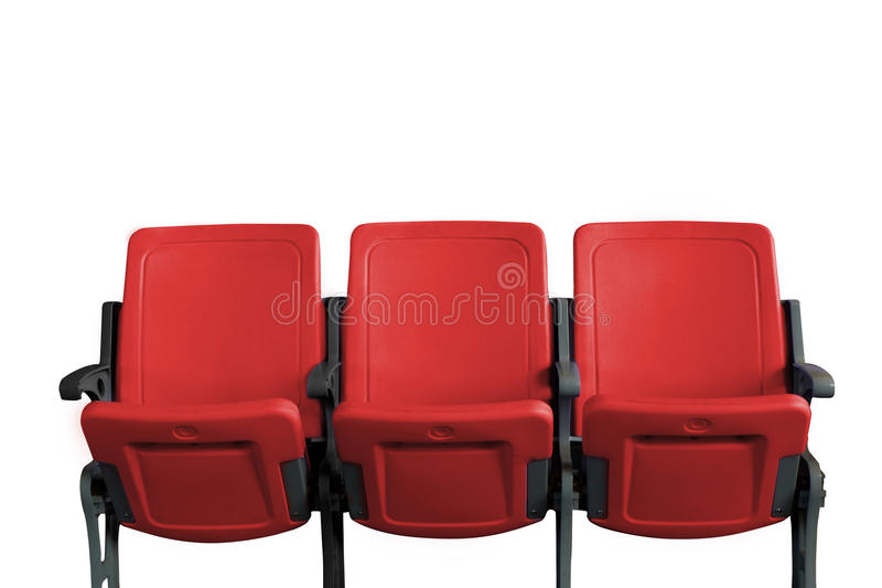 Empty theater auditorium or cinema with three red seats stock photo
