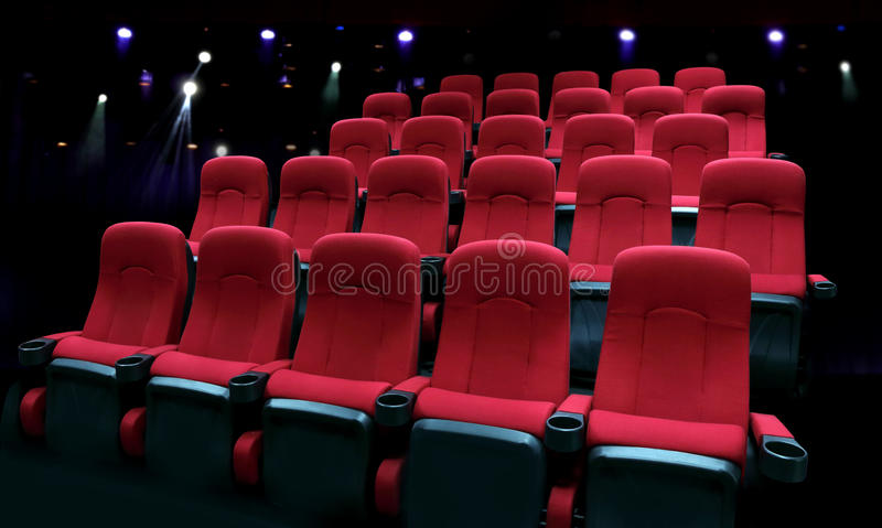Empty theater auditorium with red seats royalty free stock image