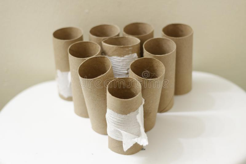 Empty Toilet Rolls Stack Up On the back of a toilet royalty free stock photos