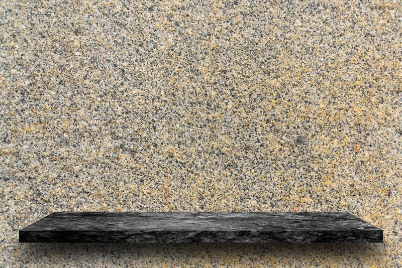 Empty top of black marble stone shelves on the brown marble wall royalty free stock images