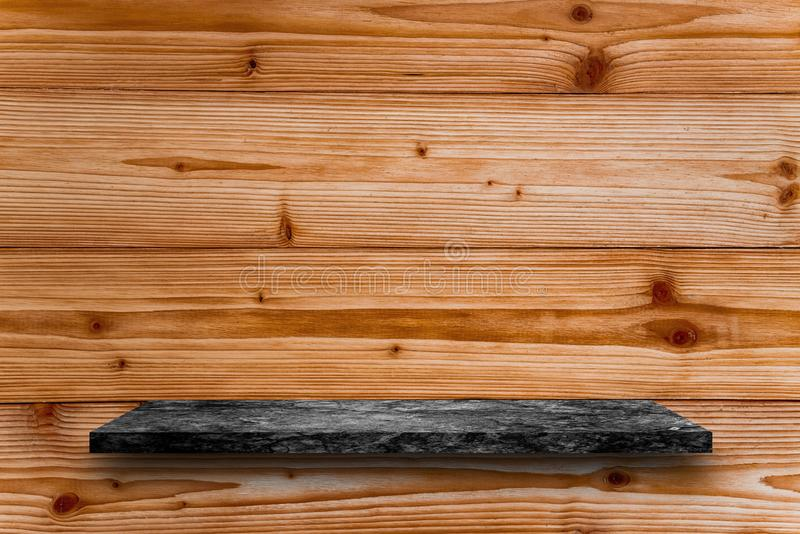 Empty top of black marble stone table on wooden plank wall background. For product display stock images