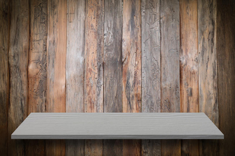 Empty top of natural wood shelves and wood plank wall background stock images