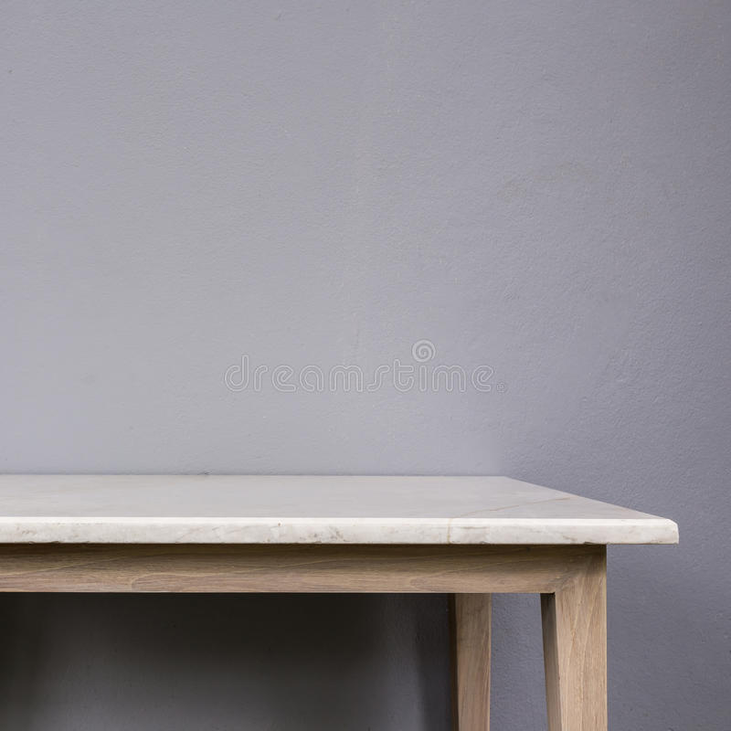 Empty top of white mable stone table on grey wall background. For product display royalty free stock photos