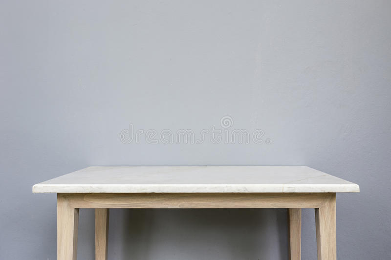 Empty top of white mable stone table on grey wall background. For product display stock images