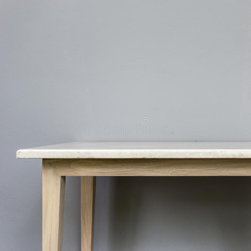 Empty top of white mable stone table on grey wall background. For product display royalty free stock image