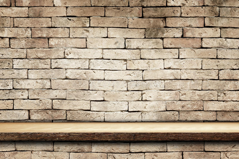 Empty top wooden shelves and brick wall royalty free stock photos
