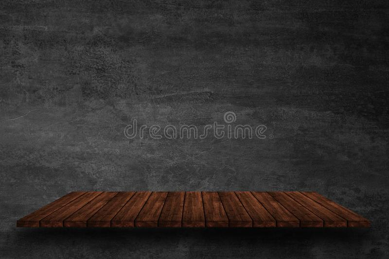 Empty top of wooden shelves on dark concrete wall background, For product display. For put product on shelves royalty free stock photography