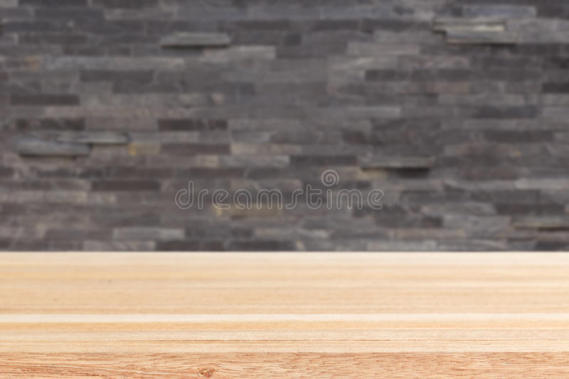 Empty top of wooden table or counter and black slat wall. Background royalty free stock photos