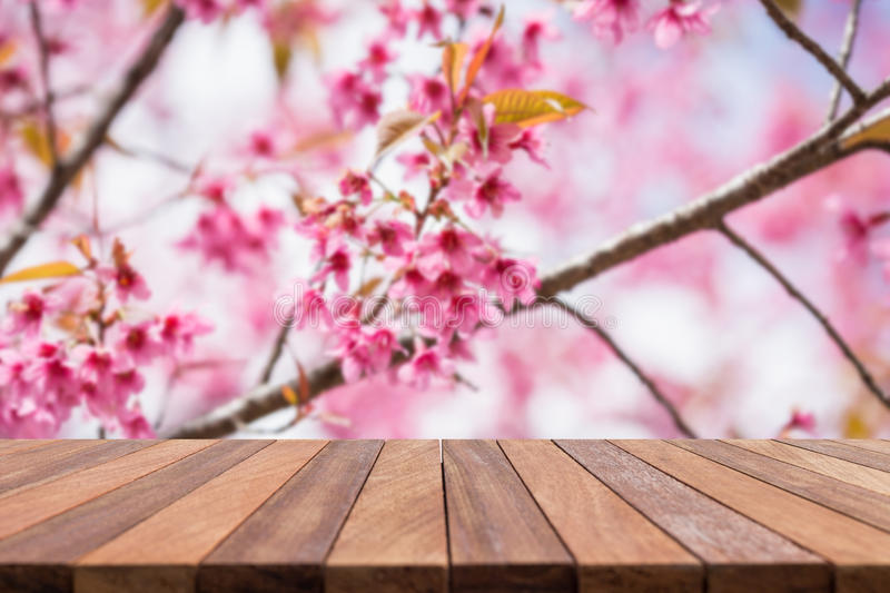 Empty top wooden table and flower field blurred background. Can use for product display royalty free stock image