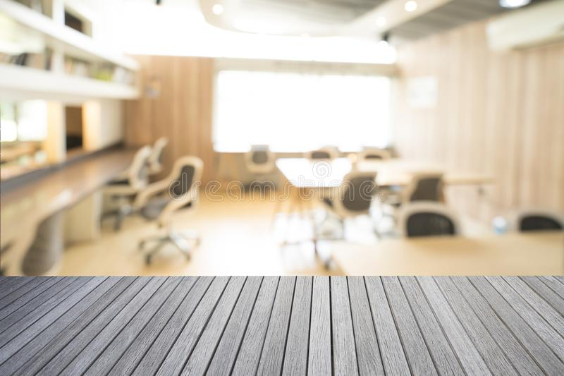 Empty top of wooden table and library room interior royalty free stock image