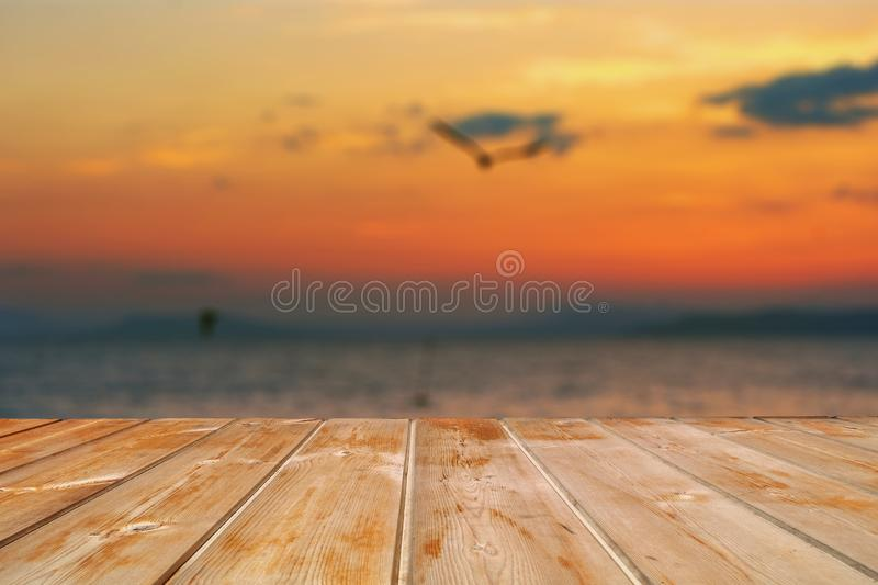 Empty top of wooden table and view of sunset or sunrise background. For product display. Море на фоне. Заготовка для дизайна royalty free stock images