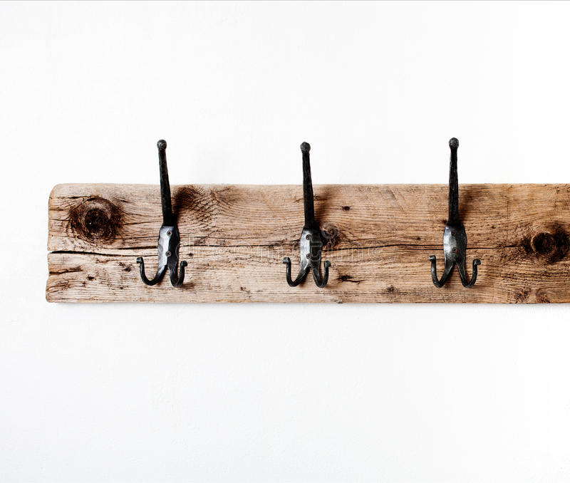 Empty towel rack. Empty wooden towel rack on white wall royalty free stock photos