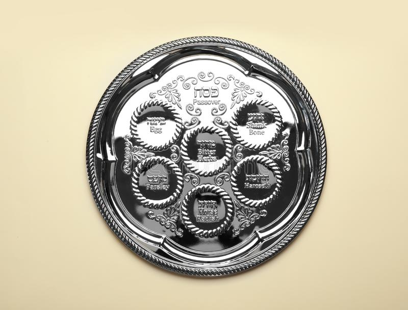 Empty traditional Passover Pesach Seder plate on color background royalty free stock photo