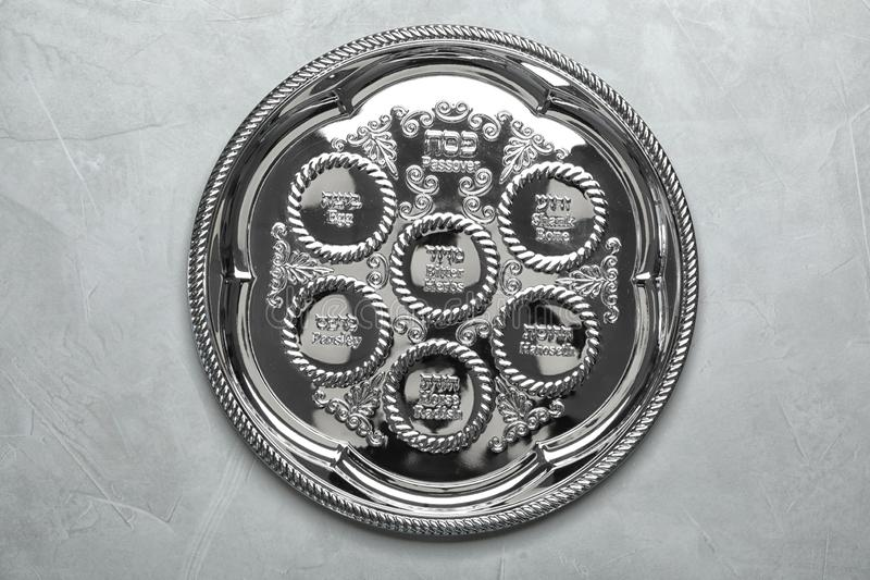 Empty traditional Passover Pesach Seder plate on color background stock image