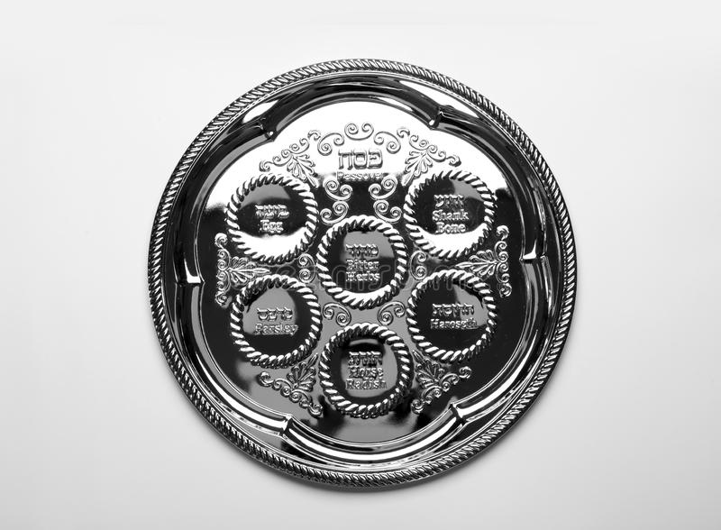 Empty traditional Passover Pesach Seder plate on white background royalty free stock images
