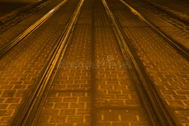 Empty tram rails and tiles. City concept. Night photo.  royalty free stock photography