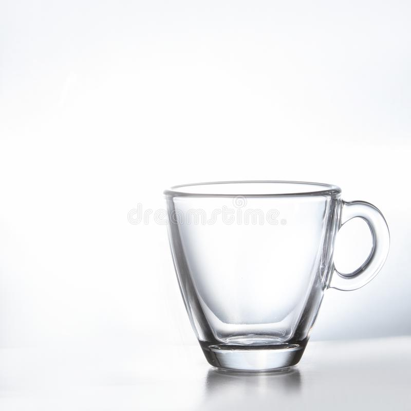 Empty transparent double wall glass tea or coffee mug isolated on white background. royalty free stock images