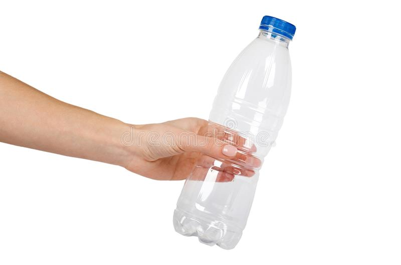 Empty transparent plastic bottle with hand. Isolated on white background, Blue cap, conteiner template.  royalty free stock image