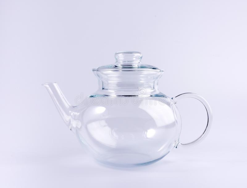 Empty transparent teapot isolated on white stock images