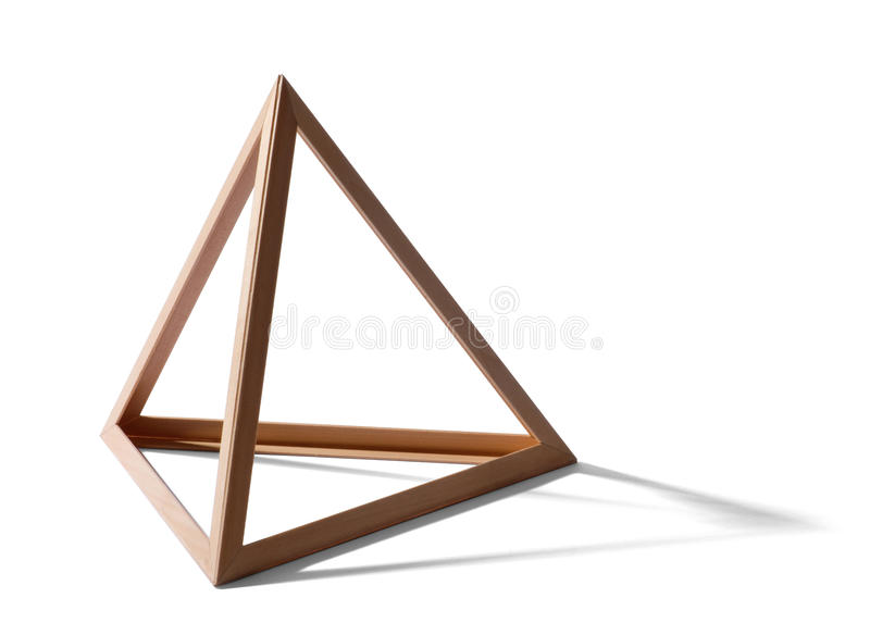 Empty triangular frame. Open empty wooden triangular pyramid shape forming a standard geometric triangle with shadow on a white background royalty free stock photography