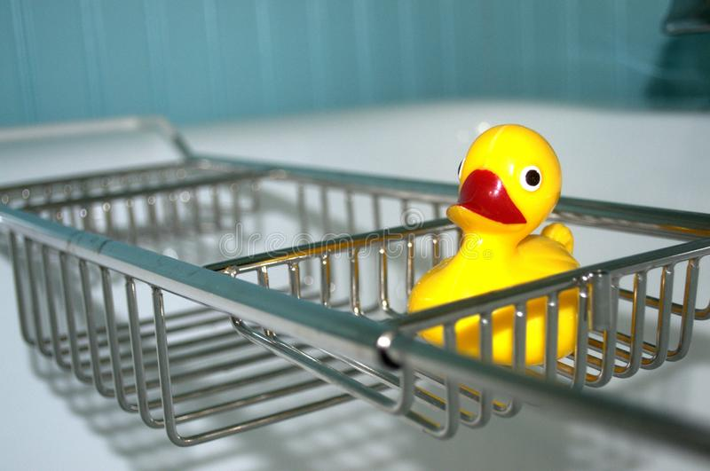 Empty tub with a yellow rubber duckie. royalty free stock photography