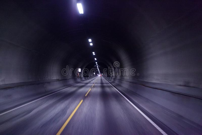 Empty tunnel road with motion blur, Norway stock photography