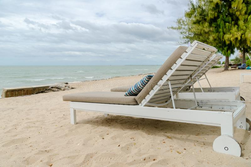 Empty two beach chairs on a beautiful beach at sunny day - vacation in summer time.  stock photo