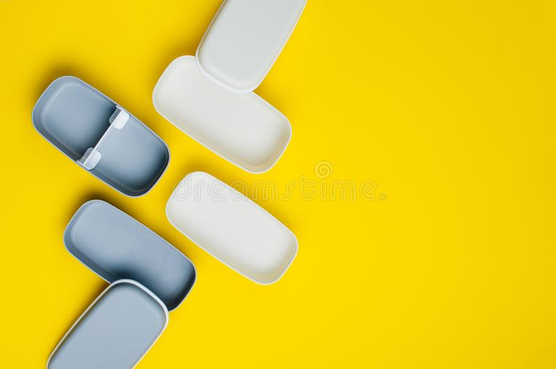 Empty two-layered lunch boxes on yellow background royalty free stock images