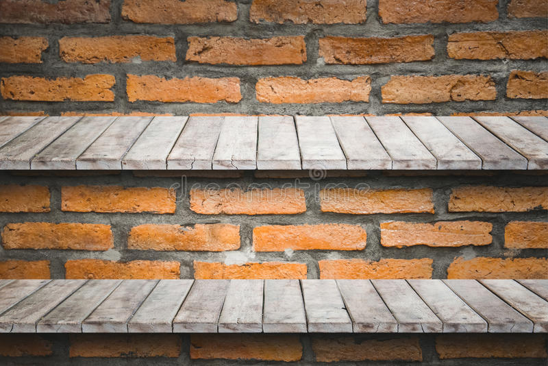 Empty two wood shelf on old brick wall background. Empty two wood shelf on old brick wall background,for product display stock photo