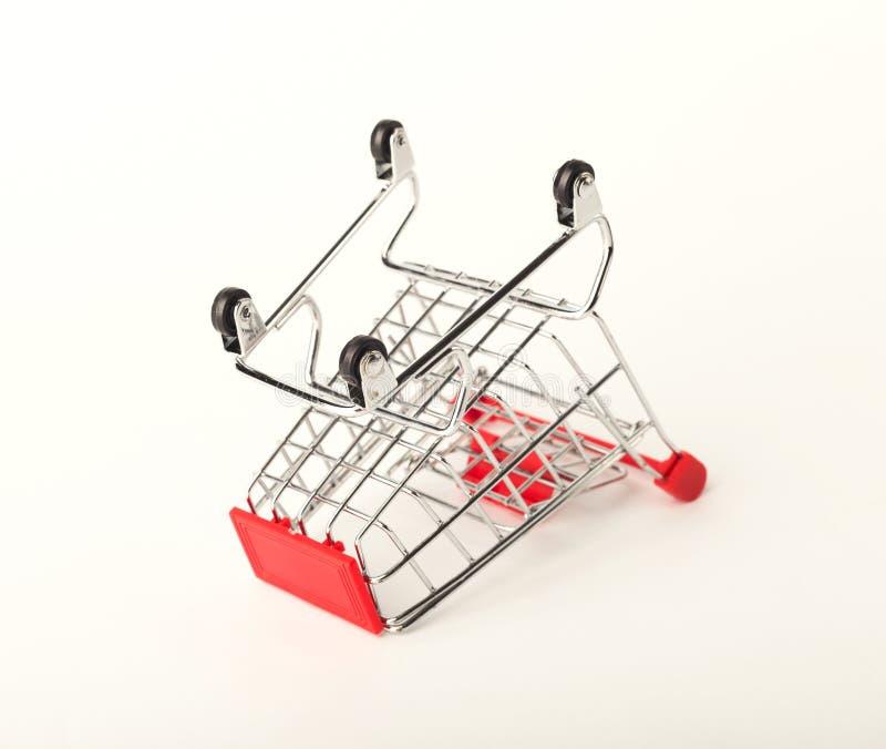 Empty upturned shopping cart isolated on white background royalty free stock photography