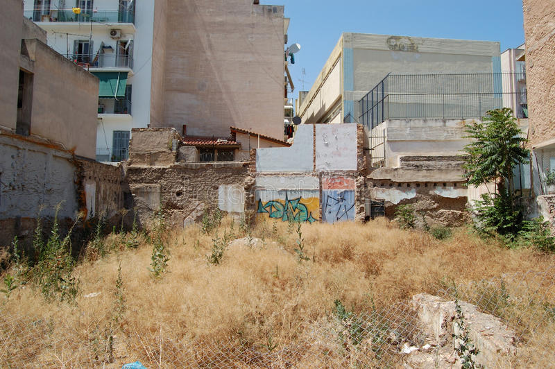 Empty urban space. Where apartment building block was demolished stock images