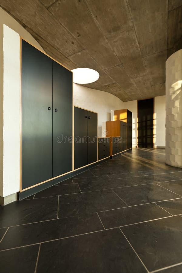 Empty villa, corridor with cabinets stock photo