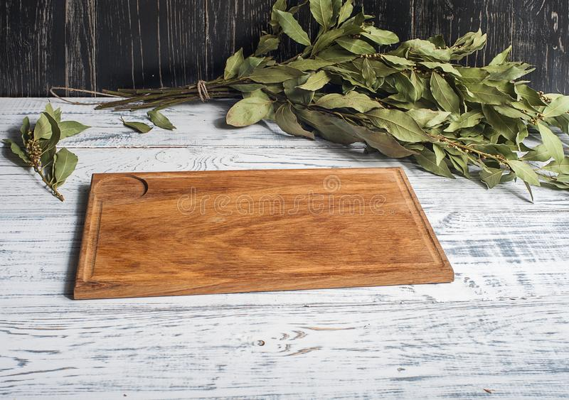 Empty vintage cutting board on planks food background concept royalty free stock image