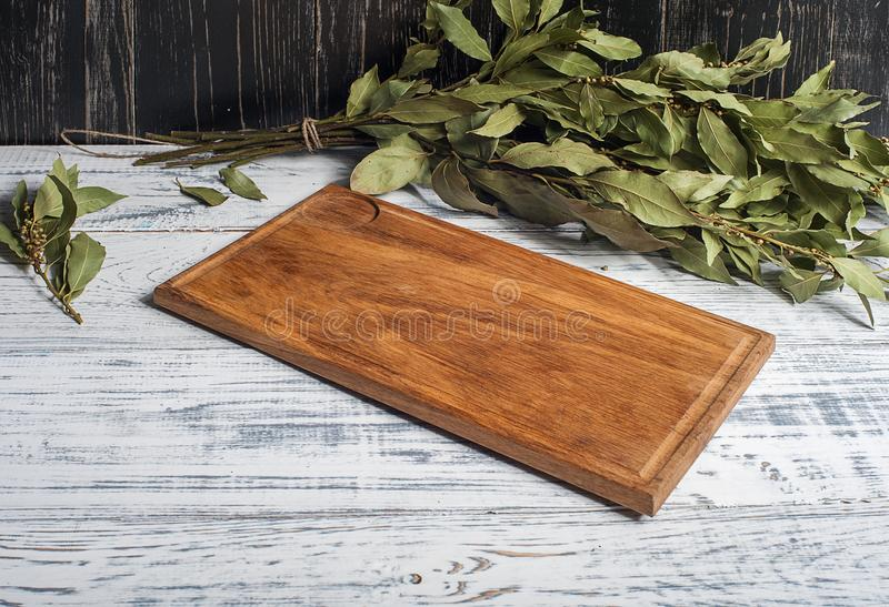 Empty vintage cutting board on planks food background concept stock photos