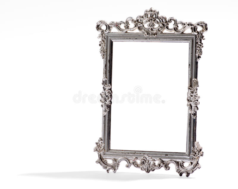 Empty vintage decorative silver frame, on white. Empty vintage decorative silver frame with elegant curled borders and shadow on white background stock image