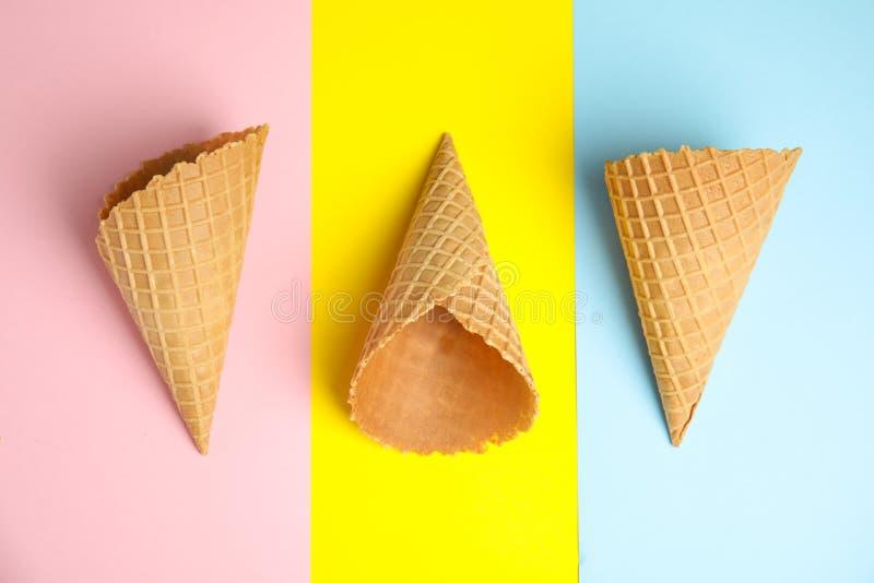Empty wafer ice cream cones, flat lay. Empty wafer ice cream cones on color background, flat lay stock images