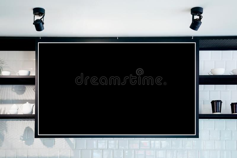 Empty wall banner at cafe mockup, front view. Coffe cups and plants on shelf in background. Scandinavian interior design royalty free stock photos