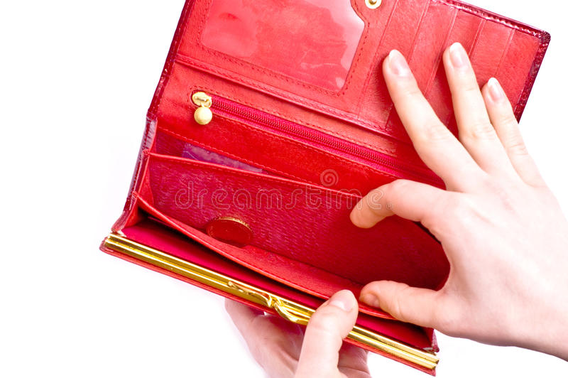 Empty wallet. Empty leather red wallet and woman hand isolated on white stock images