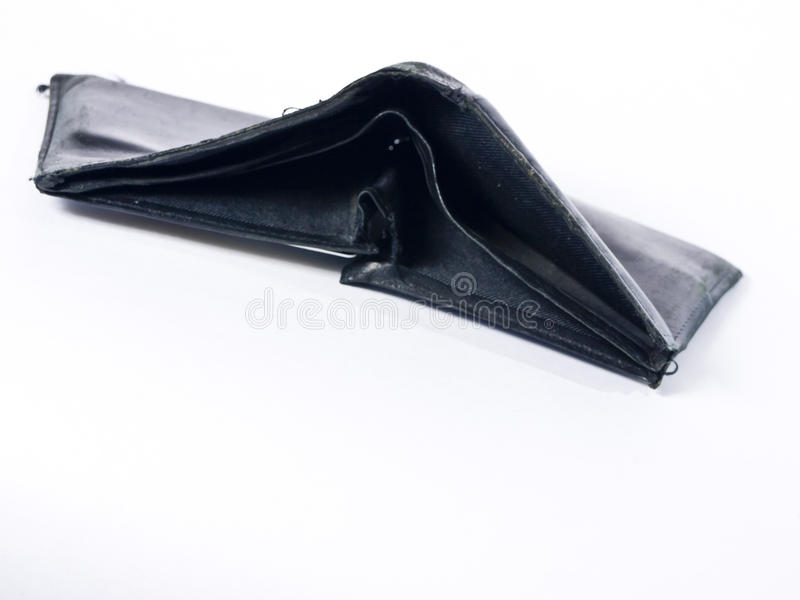 Empty Wallet. A sad looking black leather wallet or billfold hopelessly empty of cash royalty free stock photo