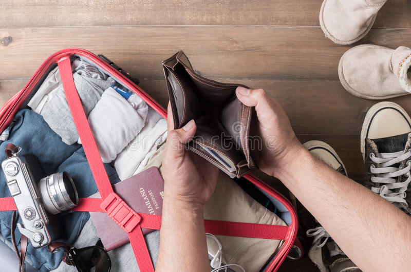 Empty wallet in the hand man on Travel accessories background royalty free stock image