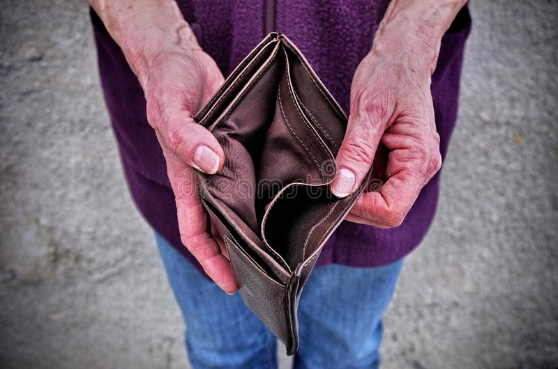 Empty wallet in the hands of an elderly woman.Global poverty. A financial crisis . royalty free stock photography