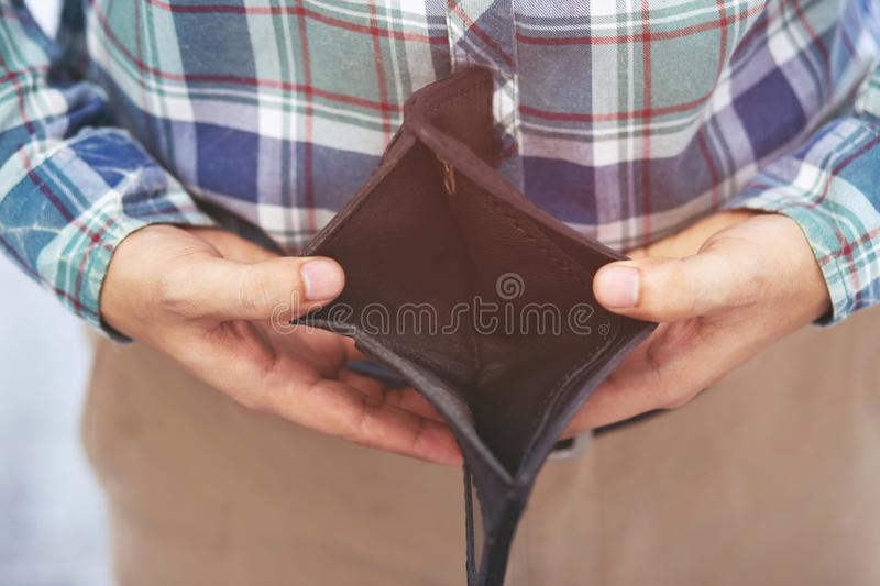 Empty wallet no money in the hands of an man. Cost control expenses poverty in concept. royalty free stock images